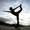 viklikesfic: Icon of a person doing a yoga stretch in silhouette in front of a sunrise (yoga)
