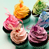 cream_kittens: Six cupcakes in a circle with brightly-coloured frosting. (Neeley)
