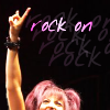 "scaramouche: Sabrina Alouche holding up rock fingers, with ""rock on"" in text (scaramouche rock on)"