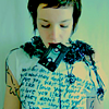 viklikesfic: Girl wearing an indie tshirt with headphones on and a cassette tape in her mouth (music)