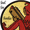 ext_3563: A little reading elf, captioned 'fool for books' (book elf)