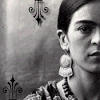 mererid: Black and white photo of artist Frida Kahlo, depicting half her face (pic#446775)