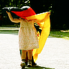 monanotlisa: little girl in football shoes, her head tangled in a german flag (deutschland)