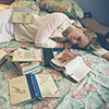 muccamukk: Woman sleeping in bed, surrounded by books. (Books: Ballycumbers)