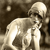 delphinapterus: Woman in cloche with hand on chin (hat - thoughtful)