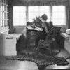 auguris: black and white photo of a woman sitting in her writing room (stayintheroom)