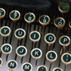 jlh: photo of old fashioned green typewriter keys (typewriter green)