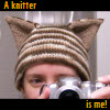 shaydchara: Me taking a picture of myself wearing a hat with cat ears (a knitter is me)