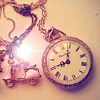 lizcommotion: image of an antique gold pocket watch with a pink flower (time)