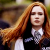 st_aurafina: Amy in her police uniform, with swishy hair (DW: Amy Pond)