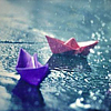 chalcopyrite: Two little folded-paper boats in the rain (Default)