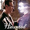 beccaelizabeth: Giles, corporeal, reaches out to touch Ethan, ghostly.  Caption, 'Haunted' (Haunted)
