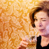 goodbyebird: Arrested development: Lucille is holding a drink and winking. (AD wink wink nudge nudge)