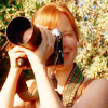 goodbyebird: Six Feet Under: Claire is taking a picture while outside. (SFU Claire)