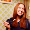 goodbyebird: 70's Show: Donne with a fork raised, smiling brightly. (70s Show Donna thinks it's yummy)