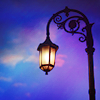 jenna_marianne: photo of an oldfashioned lamp in front of purple & blue sky (streetlamp and blue sky)