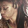 amihan: sophie okonedo as razia in 'sinbad', looking down with tattoos on her face ([sinbad] razia)