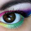 psyche29: A brown eye with rainbow eyeliner all around it (where the heart is)