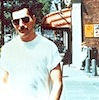 egret: Freddie Mercury walking down a sunny street (fred outside)