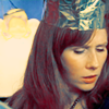 cantarina: donna noble in a paper crown, looking thoughtful (pod - redheaded headphones)