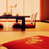 very_improbable: a low table with floor seats and a Japanese screen (red room)