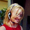 very_improbable: Dana Whittaker smiling with her headset on (headset)