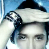 allyndra: Johnny Weir from the nose up, with his hand up to his forehead. (What do you see Johnny Weir)
