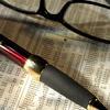delphinapterus: glasses & pen on newsprint (glasses & pen)