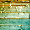 anaraine: A wall with a novelty string of lights shaped like stars strung across it. ([photo] counting stars)