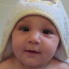 lovepeaceohana: Lulu, somewhere around six months old, smiling out from a hooded bath towel. (lucas)