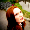 shopfront: Source: Doctor Who. Amy Pond looking up at the sky in confusion/awe. (DW - [Amy] glorious curious confusion)
