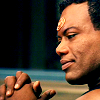 squirelawrence: Teal'c with hands clasped, looking smug. (Indeed, T'ealc smug)