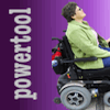 "jesse_the_k: White woman riding black Quantum 4400 powerchair off the right edge, chased by the word ""powertool"" (JK 56 powertool)"