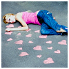 skittles: laying on chalk hearts drawn on the pavement (avatar kitty ears)