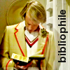 tree_and_leaf: Peter Davison in Five's cricket gear, leaning on wall with nose in book, looking a bit like Peter Wimsey. (Books)
