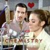 "tree_and_leaf: Brigadier watches Dr Liz Shaw at workbench.  Text ""<3 Chemistry"" (Brig/Liz)"