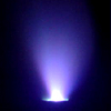 ionized: The glowing blue-purple plume of a pulsed plasma thruster against a black background. (Default)
