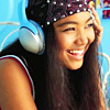 talibusorabat: Crystal Kay smiling and wearing big blue headphones (Music: Crystal Kay with headphones)