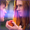 laurashapiro: The Doctor grab's Amy's hand as she holds the apple (amy and eleven)
