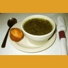 barefootbham: Bowl of greens in pot likker with a corn muffin. (Pot likker and cornbread.)