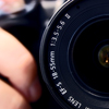 eruthros: close-up on a camera and the hand holding it (photography)