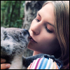 mererid: Close up photo of actress Claire Danes wearing a rainbow striped shirt and kissing a koala (Rainbow Smooch)