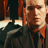 stasha2g: Ianto Jones, looking sad, with Jack walking away in the background. (TW)