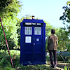 kay_brooke: The Eleventh Doctor standing in front of the TARDIS (doctor who)