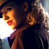 anatratrope: Olivia from Fringe in 40s garb looks over her shoulder from under a fedora (Detective Olivia)
