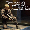 "abyssinia: Cam gating onto a ship, crouching with gun, words ""the name's Mitchell, Cam Mitchell"" (SG1 - Cam - name's Mitchell)"