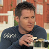 "abyssinia: Cam sitting in front of barn, holding mug of tea, words ""Cam"" (SG1 - Cam kicks back)"