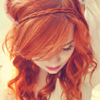 witchinthewoods: A red-haired woman looking down (Default)