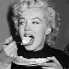innocentsmith: marilyn monroe eating a piece of cake, with gusto (marilyn: cake is nom)