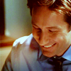amalnahurriyeh: XF: Mulder, looking down and laughing (mulder laugh)